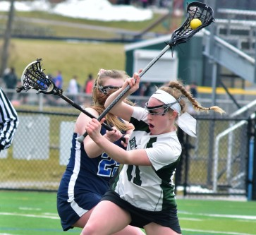 Brewster's Lauren Craft fires shot as PV's Cat Mazza defends in Bears' 9-8 loss to Tigers last Wednesday.